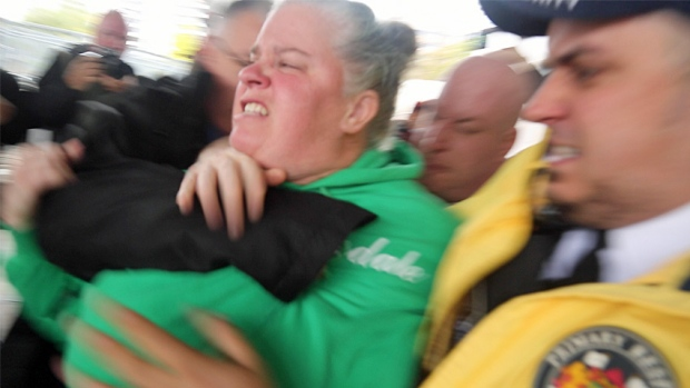 Ute Schmid-Jones, who ran for the Green Party in the 2015 federal election, was grabbed by security after she tried to throw pumpkin seeds at Prime Minister Justin Trudeau in Hamilton on Friday.